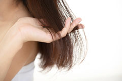 Woman taking care of her hair Royalty Free Stock Images