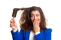 Woman taking care of her hair Stock Images