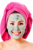 Woman taking care of her skin Stock Images