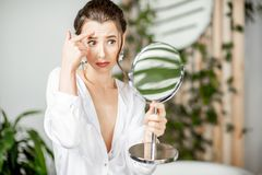 Woman taking care of her face in the bathroom royalty free stock photo