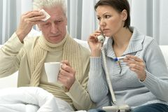 Woman taking care of ill man Stock Image