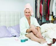 Woman taking care of leg Royalty Free Stock Photo