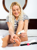 Woman taking care of leg skin Stock Images