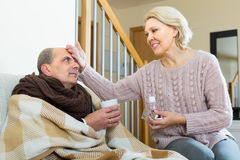 Woman taking care of senior patient Stock Image