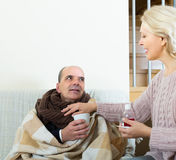 Woman taking care of senior patient Stock Images