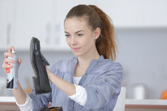 Woman taking care shoes Royalty Free Stock Photos