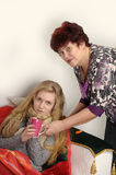 Woman taking care of a sick daughter. Woman taking care of a sick teenage daughter Stock Images