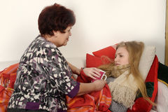Woman taking care of a sick daughter Royalty Free Stock Photo