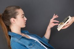 Woman taking cigarette from trap. Woman taking a cigarette from a trap Royalty Free Stock Photo