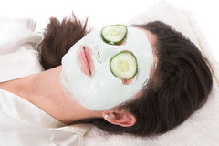 Woman taking a claymask Stock Images