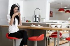 Woman taking a coffee break Royalty Free Stock Photography