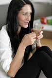 Woman taking a coffee break Stock Images