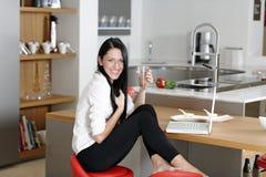 Woman taking a coffee break Royalty Free Stock Image