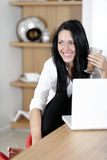 Woman taking a coffee break Stock Photo