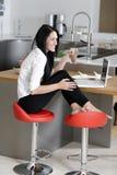 Woman taking a coffee break Stock Photography