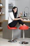 Woman taking a coffee break Stock Photos