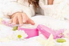 Woman taking cream. Woman's finger taking a white cream Royalty Free Stock Photos