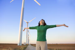 Woman taking deep breath windmills background Royalty Free Stock Image