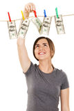 Woman taking a dollar bill from the rope Royalty Free Stock Photo