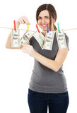 Woman taking a dollar bill from the rope Royalty Free Stock Photos
