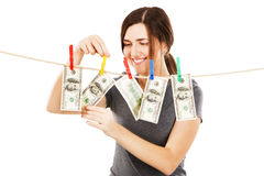 Woman taking a dollar bill from the rope Royalty Free Stock Images