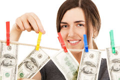 Woman taking a dollar bill from the rope Royalty Free Stock Image