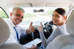 Woman taking driving lessons Stock Photo