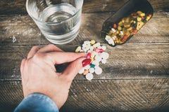Woman taking drugs Stock Image