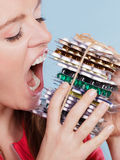 Woman taking eating pills tablets. Drug addict. Stock Photography