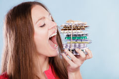 Woman taking eating pills tablets. Drug addict. Woman taking pills. Girl female eating stack of tablets. Drug addict and health care concept. Overdose Royalty Free Stock Image