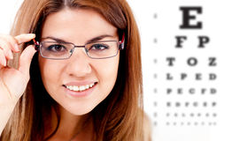 Woman taking an eye vision test Stock Images