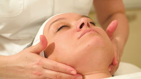 Woman taking facial treatments at beauty spa stock footage