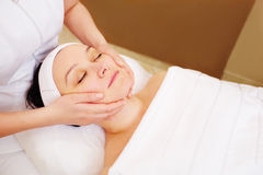Woman taking facial treatments at beauty spa Royalty Free Stock Images