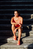 Woman taking a fitness outdoor workout rest Stock Photos