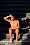 Woman taking a fitness outdoor workout rest Stock Photo
