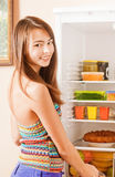 woman taking fruit out of fridge Stock Image