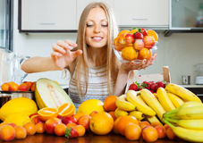 Woman taking fruits from table Royalty Free Stock Images