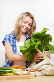 Woman taking groceries out Stock Photos
