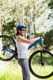 Woman taking her bike Stock Image