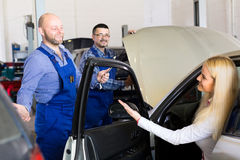 Woman taking her car for service Stock Photography