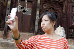 Woman taking her own selfie with background Stock Image