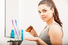 Woman taking her vitamins in the morning royalty free stock photo