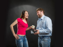 Woman taking husband's money Stock Photography