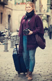 Woman taking a journey. Happy and inquisitive young woman taking a journey in the city Stock Photo