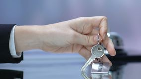 Woman taking key with hotel keychain at reception desk, luxury spa resort. Stock footage stock video footage