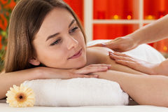 Woman taking massage Royalty Free Stock Photography