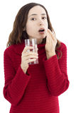 Woman taking medication Stock Images