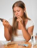 Woman taking medication Royalty Free Stock Images