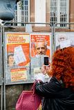 Woman taking on mobile phone Presidential campaign posters Royalty Free Stock Photos