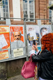Woman taking on mobile phone Presidential campaign posters Stock Photo